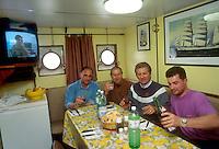 """- pusher of """"Fluviopadana"""" company with barges in navigation on the Po river, the lunch of crew....- spintore della compagnia """"Fluviopadana"""" e chiatte in navigazione sul fiume Po, l'equipaggio a pranzo"""