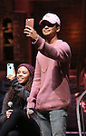 Sasha Hollinger and Jordan Fisher from 'Hamilton' greet High School students from The Rockefeller Foundation, and The Gilder Lehrman Institute of American History before a 'Hamilton' matinee performance at the Richard Rodgers Theatre on 11/30/2016 in New York City.