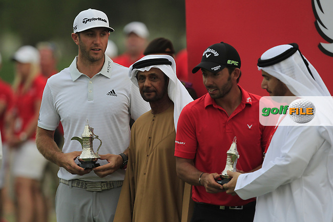 Dustin Johnson (USA) and Pablo Larrazabal (ESP) collecting their Runner-up prizes at the Abu Dhabi HSBC Championship on Sunday 22nd January 2017.<br /> Picture:  Thos Caffrey / Golffile<br /> <br /> All photo usage must carry mandatory copyright credit     (&copy; Golffile | Thos Caffrey)