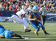 Annapolis, MD - December 28, 2017: Navy Midshipmen running back Malcolm Perry (10) runs the ball during the game between Virginia and Navy at  Navy-Marine Corps Memorial Stadium in Annapolis, MD.   (Photo by Elliott Brown/Media Images International)