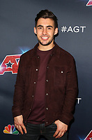 """HOLLYWOOD, CA - SEPTEMBER 10: Dom Chambers, at """"America's Got Talent"""" Season 14 Live Show Red Carpet at The Dolby Theatre  in Hollywood, California on September 10, 2019. Credit: Faye Sadou/MediaPunch"""
