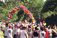 AIDS walkers finishing route under balloons at Minnehaha Falls Park.  Minneapolis Minnesota USA