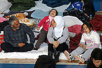 Pictured: A young family of migrants in Ierapetra basketball arena. Friday 28 November 2014<br /> Re: 700 migrants aboard a ship that lost power in the Mediterranean Sea with and was towed into a Greek harbor are being housed in a basketball arena while their refugee status was assessed.<br /> It took the Greek navy four days to tow the ship Baris from international waters into Ierapetra harbor, on the Greek island of Crete. The vessel lost power in storm-force winds.<br /> Many are Syrians fleeing the civil war. A senior health official on the island, Panayiotis Efstathiou, said many would be released.