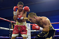 Aaron Collins (red/white shorts) defeats Lee Hallett during a Boxing Show at Bracknell Leisure Centre on 8th July 2018