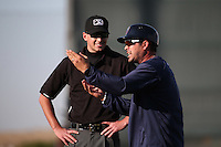 Lancaster JetHawks Manager Ramon Vazquez (12) argues a call with umpire Aaron Higgins during a game against the Bakersfield Blaze at The Hanger on June 18, 2016 in Lancaster, California. Bakersfield defeated Lancaster, 10-7. (Larry Goren/Four Seam Images)