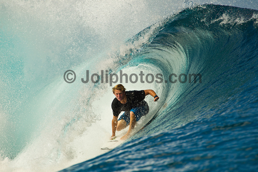 Teahupoo, Tahiti Iti, French Polynesia. Thursday August 17 2011. Dusty Payne (HAW). A south  west swell was hitting the main reef today with clean open barrels in the six foot range. Photo: joliphotos.com