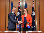 Secretary General of NATO Anders Rasmussen L and Australian Prime Minister Julia Gillard R sign a joint decleration between Australia and NATO  at Parliament House Canberra, on Thursday June 14th 2012. AFP PHOTO / Mark GRAHAM