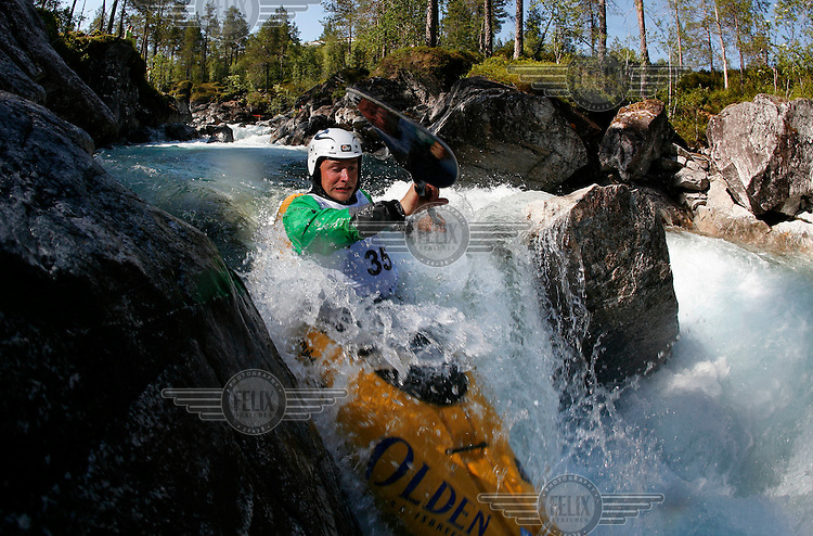 Benjamin Hjort (Norway). Kayak downhill race in the Brandseth river. <br /> <br /> The Extremesport Week, Ekstremsportveko, is the worlds largest gathering of adrenalin junkies. In the small town of Voss enthusiasts in a varitety of extreme sports come togheter every summer to compete and play. <br /> <br /> Benjamin Hjort died April 24, 2016, in an avalanche while skiing in Aurland, Norway.<br /> <br />   ©Fredrik Naumann/Felix Features.