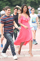 "NEW YORK, NY - JULY 11: Adam Devine and Priyanka Chopra on the set of ""Isn't It Romantic"" at Central Park on July 11, 2017 in New York City. Credit: DC/Media Punch"