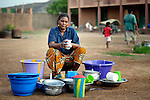 Aolizatou Maiger, a 44-year old woman from the northern village of Dire, washes her family's dishes at a Catholic training center in Niamana, Mali. Several families displaced by the fighting in northern Mali took refuge in the center, and have received support from the ACT Alliance.