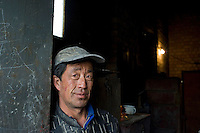 "Worker Guo Fu Qiang at a private ""rare earth"" processing plants in Guyan County about 60 km from Bayan Obo, Inner Mongolia. China produces accounts for some 97% of rare earth consumed world-wide. The ""rare earth elements"" are a group of 17 elements that are essential in 25% of modern technology including cell phones, computer hard discs, and electric motors and inparticular green technology such as electric batteries and wind turbines. China yesterday, 23 September 2010, stopped trading rare earth with Japan, who rely on Chinese imports for its high tech industry,  over a territorial dispute. .."