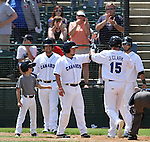 SIOUX FALLS, SD - JUNE 2:  Jared Clark #15 from the Sioux Falls Canaries is congratulated by teammates following a three run home run against the Wichita Wingnuts in the bottom of the sixth inning Sunday afternoon at the Sioux Falls Stadium. (Photo by Dave Eggen/Inertia)