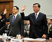 Washington, D.C. - February 24, 2010 --  Akio Toyoda, President and CEO, Toyota Motor Corporation, left, and Yoshimi Inaba, President and CEO, Toyota Motor North America, Inc., right, are sworn-in to testify before the U.S. House Committee on Government and Reform examining the Federal government's response to the recall of millions of Toyota vehicles due to reports of malfunctioning gas pedals, and to gain a better understanding of the nature of the sudden acceleration problem in Toyota vehicles and what should be done about it..Credit: Ron Sachs / CNP.(RESTRICTION: NO New York or New Jersey Newspapers or newspapers within a 75 mile radius of New York City)