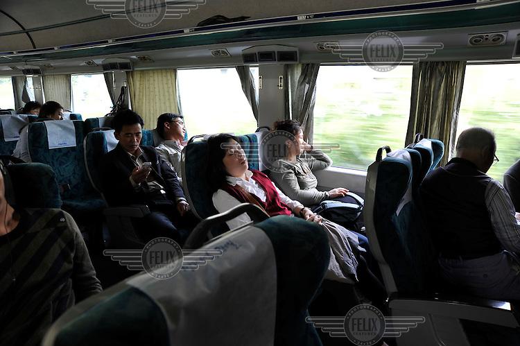 Passengers travelling aboard an intercity train, near Seoul.