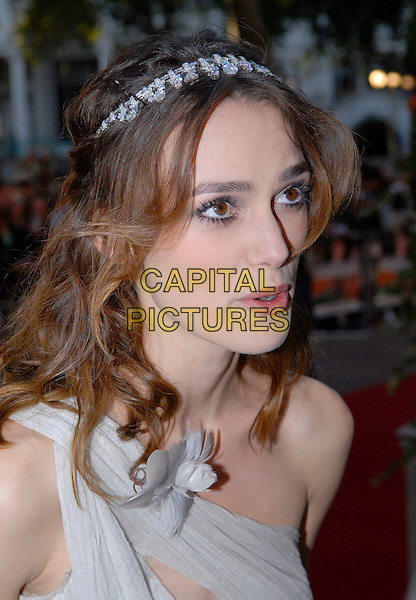 "KEIRA KNIGHTLEY.Attending the UK Film premiere of ""Atonement"", .The Odeon, Leicester Square, London, England,.September 4th 2007..knightly kiera portrait headshot funny face mouth one shoulder strap  hair band jewelled tiara hairband  flower corsage.CAP/IA.©Ian Allis/Capital Pictures"