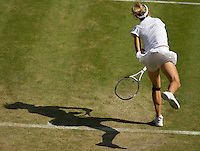 Maria Kirilenko (RUS) against Caroline Wozniacki (DEN) (9) in the second round of the ladies singles. Wozniacki beat Kirilenko 6-0 6-4..Tennis - Wimbledon - Day 4 - Thur 25th June 2009 - All England Lawn Tennis Club  - Wimbledon - London - United Kingdom..Frey Images, Barry House, 20-22 Worple Road, London, SW19 4DH.Tel - +44 20 8947 0100.Cell - +44 7843 383 012