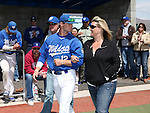 Western Nevada College's Christian Stolo escorts his family onto the field for Sophomore Day festivities at John L. Harvey field, on Sunday, April 27, 2014, in Carson City, Nev.<br /> Photo by Cathleen Allison/Nevada Photo Source