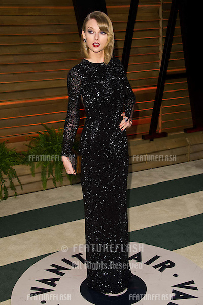 Taylor Swift arriving for the 2014 Vanity Fair Oscars Party, Los Angeles. 02/03/2014 Picture by: James McCauley/Featureflash