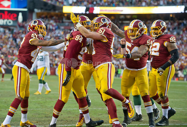 Washington Redskins defense celebrates after forcing a safety early in the first quarter against the Green Bay Packers in an NFC Wild Card game at FedEx Field in Landover, Maryland on Sunday, January 10, 2016. Pictured, from left to right: Washington Redskins cornerback Quinton Dunbar (47), defensive end Preston Smith (94), who forced the safety, inside linebacker Will Compton (51), inside linebacker Mason Foster (54), and defensive end Chris Baker (92).<br /> Credit: Ron Sachs / CNP/MediaPunch ***FOR EDITORIAL USE ONLY***