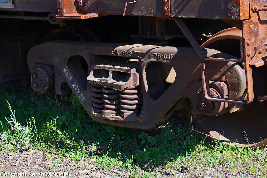 Detail of a rusty, abandoned train car on Railroad Avenue in Willits in Mendocino County in Northern California.