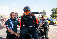 Sep 29, 2019; Madison, IL, USA; NHRA top fuel driver Mike Salinas (right) with crew members during the Midwest Nationals at World Wide Technology Raceway. Mandatory Credit: Mark J. Rebilas-USA TODAY Sports