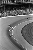 INDIANAPOLIS, IN - MAY 24: AJ Foyt drives his Coyote 81 1/Cosworth through Turn 1 ahead of Al Unser, Tom Sneva, Gordon Johncock and Gordon Smiley during early laps of the Indianapolis 500 USAC/CART Indy Car race at the Indianapolis Motor Speedway in Indianapolis, Indiana, on May 24, 1981.