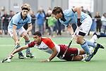 ALMERE - Hockey - Hoofdklasse competitie heren. ALMERE-HGC (0-1) .  Daniel de Haan (Almere) met rechts Weigert Schut (HGC)  en links Thijmen Piket (HGC) COPYRIGHT KOEN SUYK