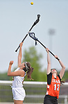O'Fallon's Alexa Prouhet (left) reaches for the ball on the restart after a goal. At right is Minooka's Elizabeth Cullen. O'Fallon played Minooka in a quarterfinal game of the O'Fallon sectional at O'Fallon Sports Park on Monday May 20, 2019. <br /> Tim Vizer/Special to STLhighschoolsports.com