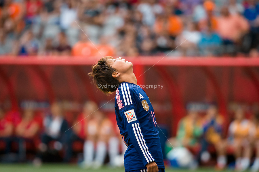 June 23, 2015: Shinobu OHNO of Japan reacts after missing a kick for goal during a round of 16 match between Japan and Netherlands at the FIFA Women's World Cup Canada 2015 at BC Place Stadium on 23 June 2015 in Vancouver, Canada. Japan won 2-1. Sydney Low/AsteriskImages.com