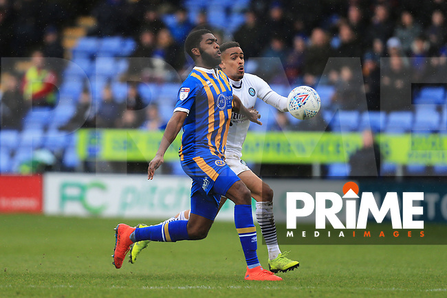 Ro-Shaun Williams of Shrewsbury Town and Paris Cowan-Hall of Wycombe Wanderers during the Sky Bet League 1 match between Shrewsbury Town and Wycombe Wanderers at Greenhous Meadow, Shrewsbury, England on 16 March 2019. Photo by Leila Coker / PRiME Media Images.