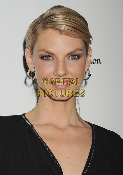 Angela Lindvall.W Magazine's 69th Annual Golden Globe Awards Celebration held at The Chateau Marmont, West Hollywood, California, USA..13th January 2012.headshot portrait hoop earrings silver black .CAP/ROT/TM.©Tony Michaels/Roth Stock/Capital Pictures