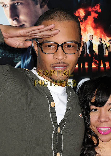 """T.I., Tip Harris, Clifford Joseph Harris Jr..""""Gangster Squad"""" Los Angeles Premiere held at Grauman's Chinese Theatre, Hollywood, California, USA..January 7th, 2013.headshot portrait white green glasses   goatee facial hair hand arm salute .CAP/ADM/BP.©Byron Purvis/AdMedia/Capital Pictures."""