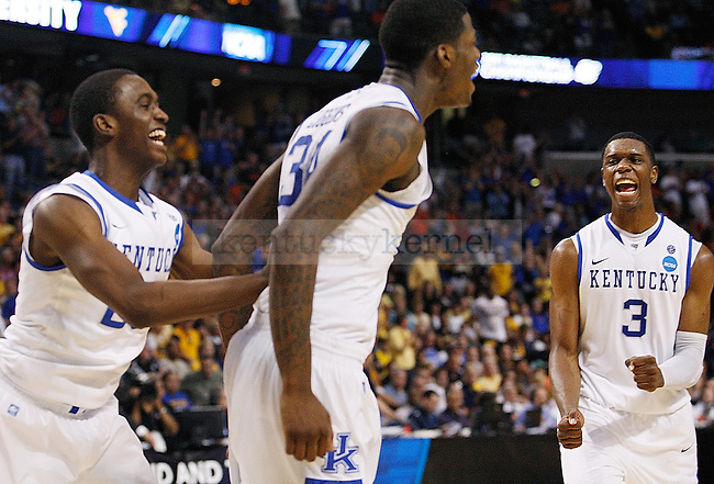 Terrence Jones, Doron Lamb and DeAndre Liggins celebrate after UK's second round NCAA tournament win, 71-63, against West Virginia at the St. Pete Times Forum in Tampa, Florida on Saturday, March 19, 2011.  Photo by Britney McIntosh | Staff