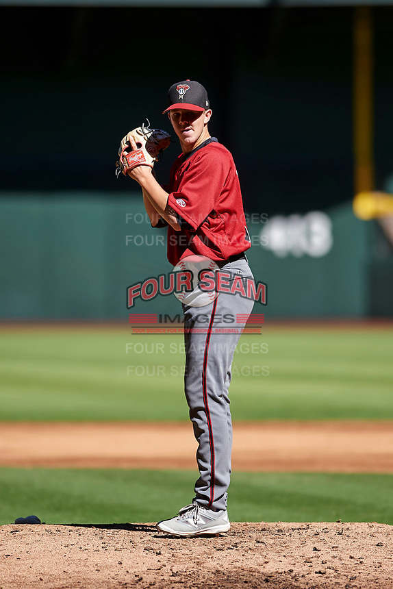 Matt Tabor (31), the Arizona Diamondbacks third round selection of the 2017 MLB Draft, prepares to deliver a pitch to the plate during an Instructional League game against the Kansas City Royals on October 14, 2017 at Chase Field in Phoenix, Arizona. (Zachary Lucy/Four Seam Images)