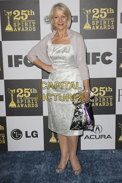 DAME HELEN MIRREN .25th Annual Film Independent Spirit Awards held At The Nokia LA Live, Los Angeles, California, USA,.March 5th, 2010 ..arrivals Indie Spirit full length hand on hip white silver dress shrug cardigan bag clutch peep toe shoes patterned pattern .CAP/ADM/KB.©Kevan Brooks/Admedia/Capital Pictures