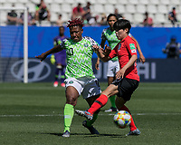 GRENOBLE, FRANCE - JUNE 12: Rita Chikwelu #10 of the Nigerian National Team blocks pass by Soyun Ji #10 of the Korean National Team during a game between Korea Republic and Nigeria at Stade des Alpes on June 12, 2019 in Grenoble, France.