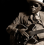 Late, great Bluesman John Lee Hooker with his guitar backstage before a club performance.  .His music influenced the likes of The Rolling Stones, Eric Clapton, The Who, John Mayall and Van Morrison..Hooker was a member of the Rock and Roll Hall of Fame..(August 22, 1917 – June 21, 2001)
