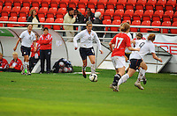 Carli Lloyd challenges the Norwegian defense. The USA defeated Norway 2-1 at Olhao Stadium on February 26, 2010 at the Algarve Cup.