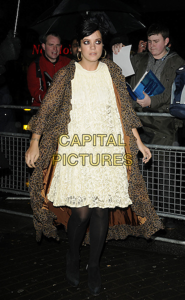 LILY ALLEN.The Shockwaves NME Awards 2010 held at Brixton Academy, London, England. .February 24th, 2010.full length white cream lace dress brown leopard print coat black tights .CAP/CAN.©Can Nguyen/Capital Pictures.