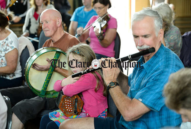 Musicians taking part in the Frank Custy session in progress on Thursday at the Holy Family National School during Fleadh Cheoil na hEireann in Ennis. Photograph by John Kelly.