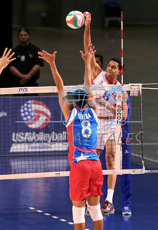 Dominican Republic's Capellan Lopez hits against Puerto Rico blocker Eddie Rivera during the Pan American Cup at the Reno Events Center in Reno, Nev., on Monday, Aug. 17, 2015. <br /> Photo by Cathleen Allison