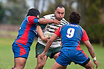 Sami Soane gets tackled by Robinson Avei as Samisoni Halanukonuka  moves in to assist. Counties Manukau Premier Club Rugby game between Manurewa and Ardmore Marist played at Mountfort Park, Manurewa on Saturday June 19th 2010..Manurewa won the game 27 - 10 after leading 15 - 5 at halftime.