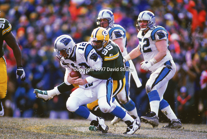 Green Bay Packers defensive lineman Keith McKenzie (95) sacks Carolina Panthers quarterback Kerry Collins the NFC Championship NFL football game at Lambeau Field on October 27,1996 in Green Bay, Wisconsin. The Packers won 13-7. (Photo by David Stluka)