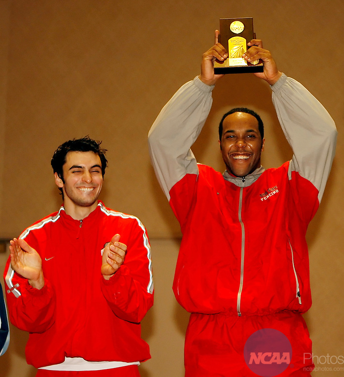 17 MARCH 2006: Adam Crompton of Ohio State, right, raises his gold medal trophy for winning the Saber competition at the Division I Men's Fencing Championship held at the J.W. Marriott in Houston, TX. Teammate Jason Rogers, left, won the bronze medal. Dave Einsel/NCAA Photos