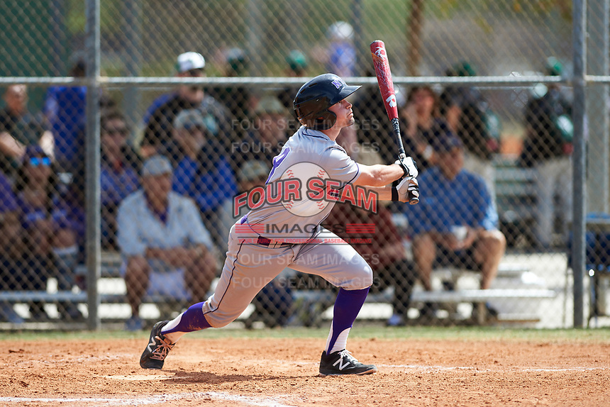 New York University Violets center fielder Jack Walter (8) at bat during a game against the Edgewood Eagles on March 14, 2017 at Terry Park in Fort Myers, Florida.  NYU defeated Edgewood 12-7.  (Mike Janes/Four Seam Images)