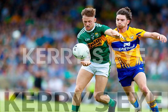 Barry John Keane Kerry in action against Cian O'Dea Clare during the Munster GAA Football Senior Championship semi-final match between Kerry and Clare at Fitzgerald Stadium in Killarney on Sunday.