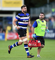 Elliott Stooke of Bath Rugby leaves the field with medic Declan Lynch. Aviva Premiership match, between Bath Rugby and Saracens on September 9, 2017 at the Recreation Ground in Bath, England. Photo by: Patrick Khachfe / Onside Images
