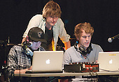 Setting up laptops for the DJ sessions.  Students on the 2yrs National Diploma in Music course put on an evening of bands at the Grey Horse pub, Kingston upon Thames.  They would have organised everything themselves: marketing, DJ-ing, production and performing.