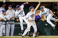 Team coming on the field to celebrate victory April 27th, 2010; NCAA Baseball action, Baylor University Bears vs TCU Horned Frogs at Lupton Stadium in Fort Worth, Tx;  TCU won 5-4 in extra innings.