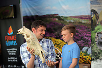 Pictured L-R: Rhodri Jones of Blaenau Gwent Council with Dylan Shepherd, 5. Saturday 13 August 2016<br />Re: Grow Wild event at  Furnace to Flowers site in Ebbw Vale, Wales, UK